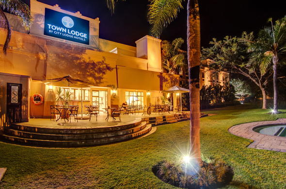 Exterior view of Town Lodge Polokwane at night.